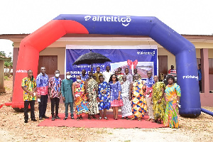 Officials of Airteltigo, headmaster of the schools, others in a group photograph