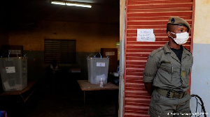 A member of the security force guarding a polling station in Ouagadougou