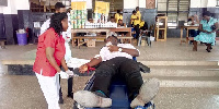A student donating his blood