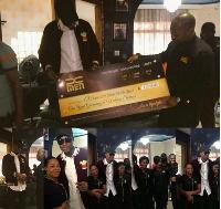 E.L receiving the award from XMEN