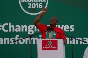 Former president John Mahama on a podium during a campaign tour