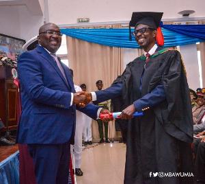 Johnson Asiedu Nketia receiving his certificate from Vice President Mahamudu Bawumia