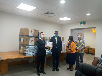 ZHU Jing handing over the medical supply to Dr Bernard Okoe-Boye