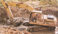 File photo of some miners mining with an excavator