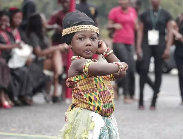 A child displaying her Adowa dance skills at the funeral grounds