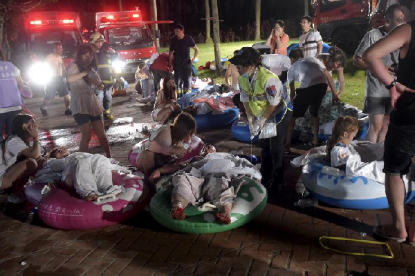 Injured victims from an accidental explosion during a music concert lie on the ground  June 27, 2015