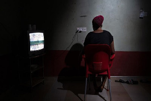 Blessing, a 26-year-old from Nigeria, inside the guesthouse where she lives with other 20 women