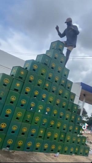 The Ghanaian man captured climbing the crates
