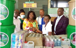 Della Sowah donating the items to the hospital