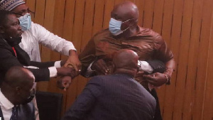 Carlos Ahenkorah (in brown) accosted over ballot snatching