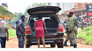 Security personnel check a vehicle heading to Magere, home of Bobi Wine (DAILY MONITOR)