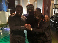 Shatta Wale, Bulldog in a hearty handshake with media mogul, Bola Ray at the Zylofon Media premises