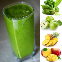 A glass of tropically green smoothie