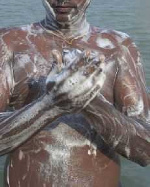 NPP supporter takes his bath on the street