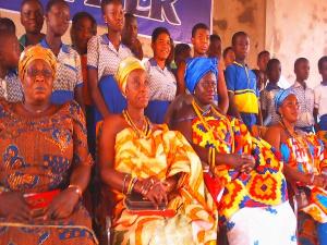 Nana Aplam II with school girls in the Manya Krobo Traditional area