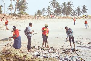 Staff of Lucosade Ghana cleaning the Osu beach