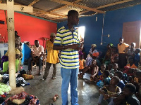 Richard Opoku, Project Coordinator of Empowerment Aid interacts with participants
