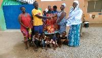 Mr Tweneboah Kodua (second left) making the presentation to the orphanage