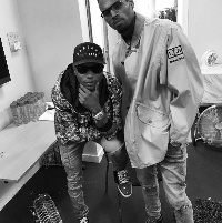 Wizkid and Chris Brown pose for a photo after performance.