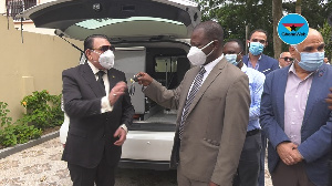 Euroget CEO, Dr Said Deraz handing over the keys of the ambulance to Dr Patrick Aboagye