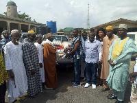 Hon Gilbert Ken Asmah making donation to the Muslim community