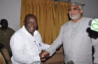 J.J. Rawlings (right) in a handshake with president-elect Akufo-Addo