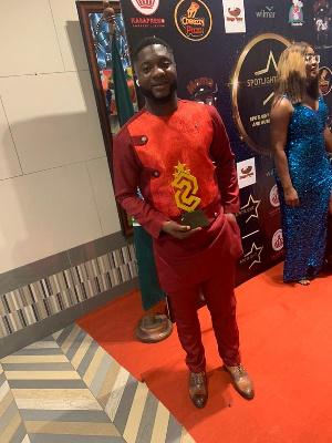 Derrick Ayim with his award