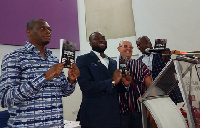 Fadi Dabbousi (2nd left) and Dr Nyamkum (right) launching the book