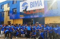 Some BIMA staff in a group picture after clean-up exercise