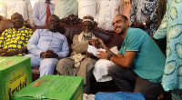 Mr.Kalmoni( right) presenting the undisclosed amount of money to the National Chief Imam