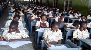 Some students writing examination