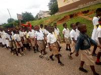 Pupils demonstrating against classroom defecation