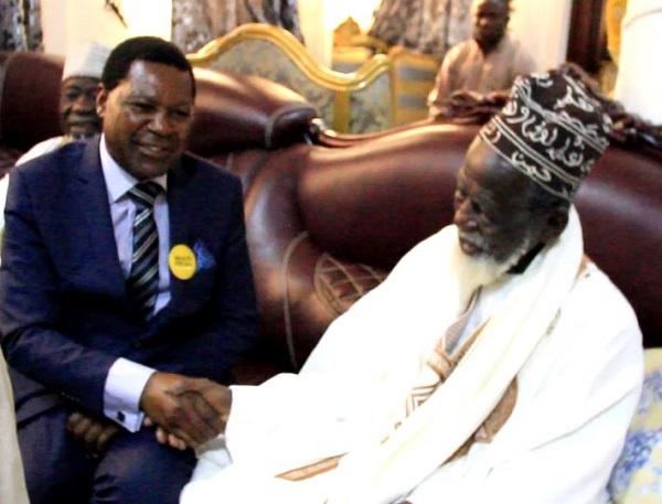 CEO of NHIA in a handshake with the National Chief Imam, Sheikh Nuhu Sharubutu