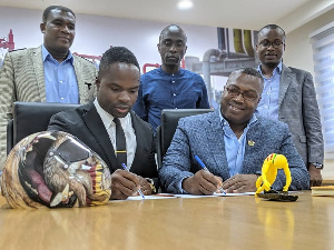 Akwasi Frimpong and  Ghana Gas CEO Dr. Ben Asante signing the contract