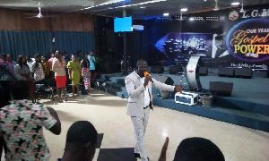 Reverend Emmanuel Eshun speaking to his congregation