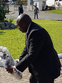 Kwabena Agyapong lays a wreath at a ceremony held to honour the 3 Justices of the High Court