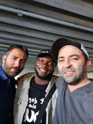 Ghanaian attacker Abdul Basit Adam(middle)