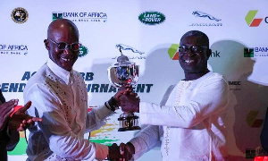 A member of the Ahimota Golf Club receiving the trophy