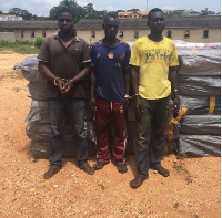 The three arrested suspects behind the bales of wee