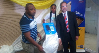 Maxwell Techie (left), CEO, TECNO Mobile and Asher Khan (right), CMO, MTN unveiling Camon CX