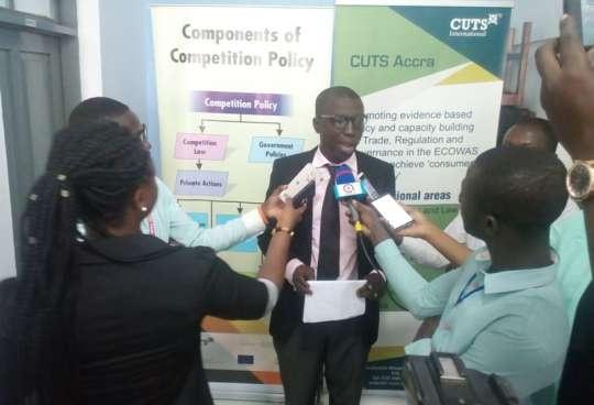 Country Director of CUTS International, Ghana, Mr Appiah Kusi Adomako (C)
