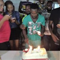 Bismark The Joke cutting his birthday cake