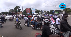 Hundreds of gleeful motorbike riders gleefully swamed the Vice President's motorcade