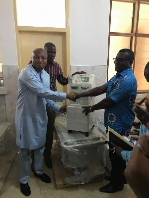 Samuel Okudzeto Ablakwa presenting medical equipment to the Battor Catholic Hospital