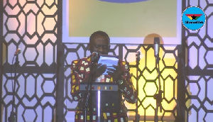 Akrobeto reading the Bible at MTN 9 Lessons and Carols