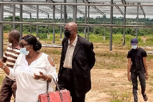 Dr. Joseph Yaw Mensah (in black mask) is a United States-based Ghanaian investor