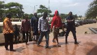 The suspects entering the court premises