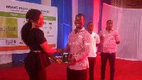 Mr Bennet Ashie (R) receiving the award from Ms Ewurabena Bilson, an Executive of Delta Capital