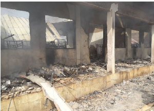 The fire destroyed five rooms and displaced 215 students
