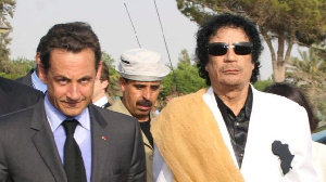 File photo of Gaddafi and ex French president Nicolas Sarkozy